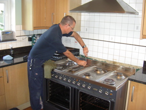 The engineer, Steve, repairing a dual fuel cooker